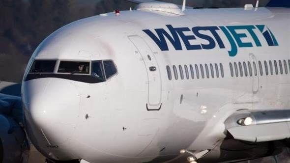 (WestJet)客机机翼相撞.(图/加新社)-温哥华机场两客机机翼相图片